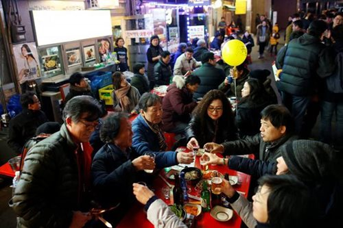 Slogans, placards and food: South Korean protests a boon for restaurants