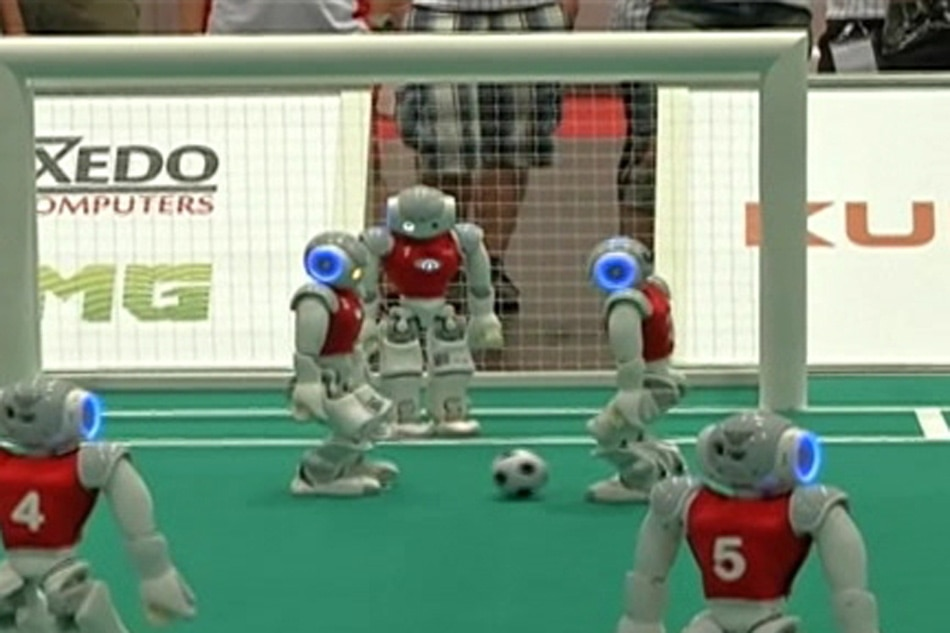 LOOK: Football-playing robots in Germany