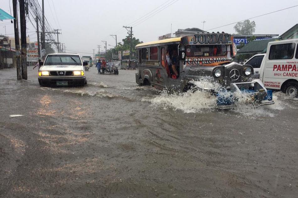 LOOK: Floods swamp Metro Manila, nearby provinces 12