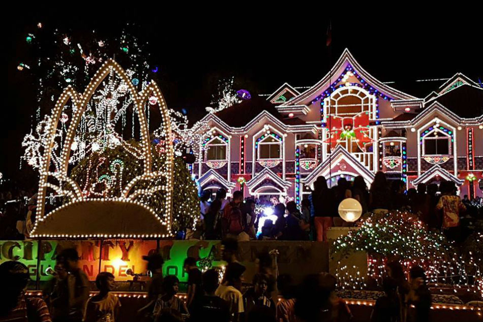Locals and tourists are greeted by a crown-like image made of Christmas lights at the entrance. Colorful lights outline the entire structure of the ...