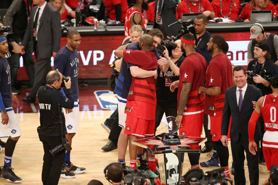 69a88e1e7 Kobe Bryant (24) of the Western Conference hugs Pau Gasol (16) of the  Eastern Conference after the 2016 NBA All-Star Game on February 14